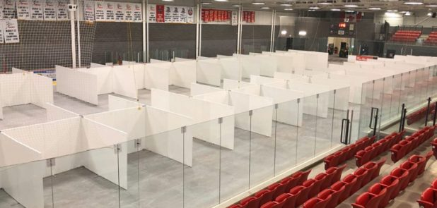 norlock wall panel application, healthcare. temporary cubicles in a hockey arena.